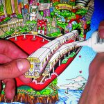 hand glueing a subway train car to a 3d pop art peice done by Charles Fazzino