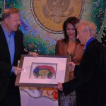 Charles Fazzino presents artwork to Elie Weisel as Giselle Fernandez looks on at The Jefferson Awards ceremony