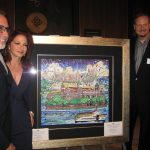Gloria and Emilio Estefan stand with Charles Fazzino and his original painting for the Ellis Island Medal of Honor Awards