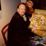 Charles Fazzino signs posters with supermodel Petra Nemcova at The GRAMMY Awards