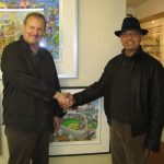 Reggie Jackson and Charles Fazzino shaking hands at the artists studio when the Yankee legend stopped by for a visit.