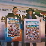 Charles Fazzino appears with racing legend Richard Petty to unveil his artwork for the Daytona 500