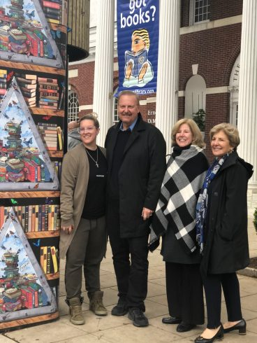 Image of Heather Fazzino, Charles Fazzino, Alice Knapp, President of Ferguson Library and Sandy Goldstein standing next to the commissioned kiosk.