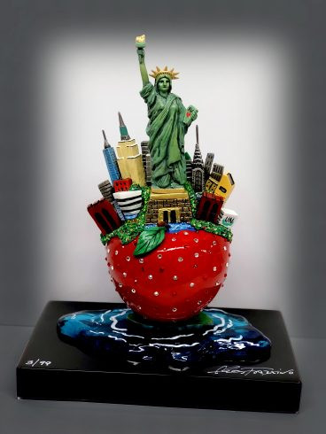 An image of Charles Fazzino's first bronze and pewter sculpture. A classic Fazzino Big Apple New York cityscape replete with the Statue of Liberty, Empire State Building, Chrysler Building, and all of the major landmarks. Brilliantly hand-painted with the mind-boggling detail typically found in a Charles Fazzino limited edition print. The bronze apple is dazzling and covered with hand-applied Swarovski Crystals.