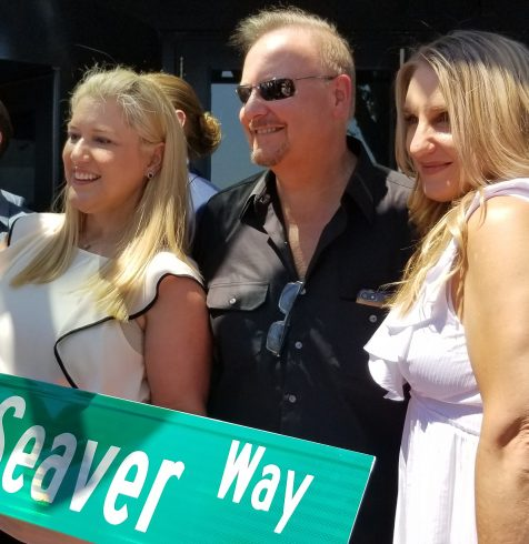 Charles Fazzino with Annie and Sarah Seaver holding the Seaver Way sign
