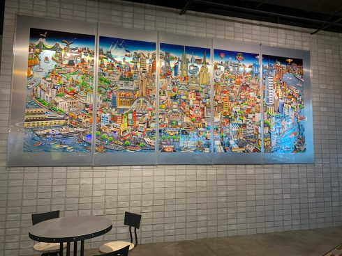 Close up of a colorful Charles Fazzino mural in the mall food court.