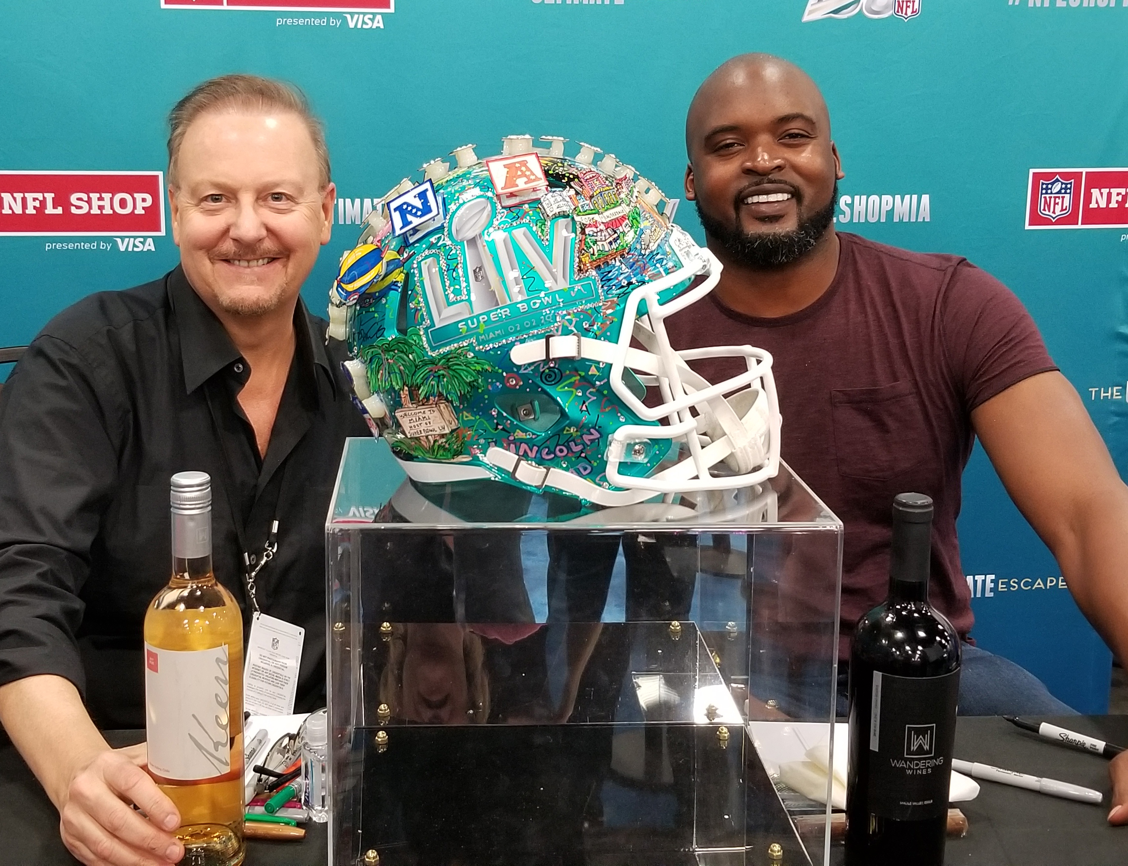 Charles Fazzino with Former NY Giant Mathias Kiwanuka, pictured with Super Bowl helmet and wine.