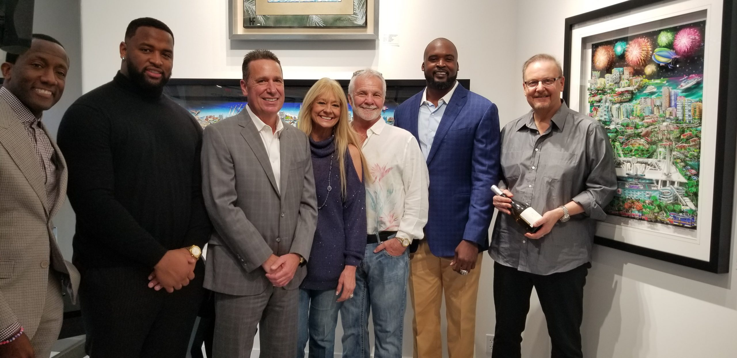 Super Bowl art unveiling at Wentworth Gallery in the Hard Rock Hotel & Casino in Hollywood, FL. Attendees included (from left to right): Donovan Campbell, Miami Dolphin Davon Godchaux, President of the Hard Rock Hotel & Casino Bo Guidry, Winterfest CEO and President Lisa Scott-Founds, Bravo Television Personality Captain Lee, Former NY Giant Mathias Kiwanuka, and Charles Fazzino