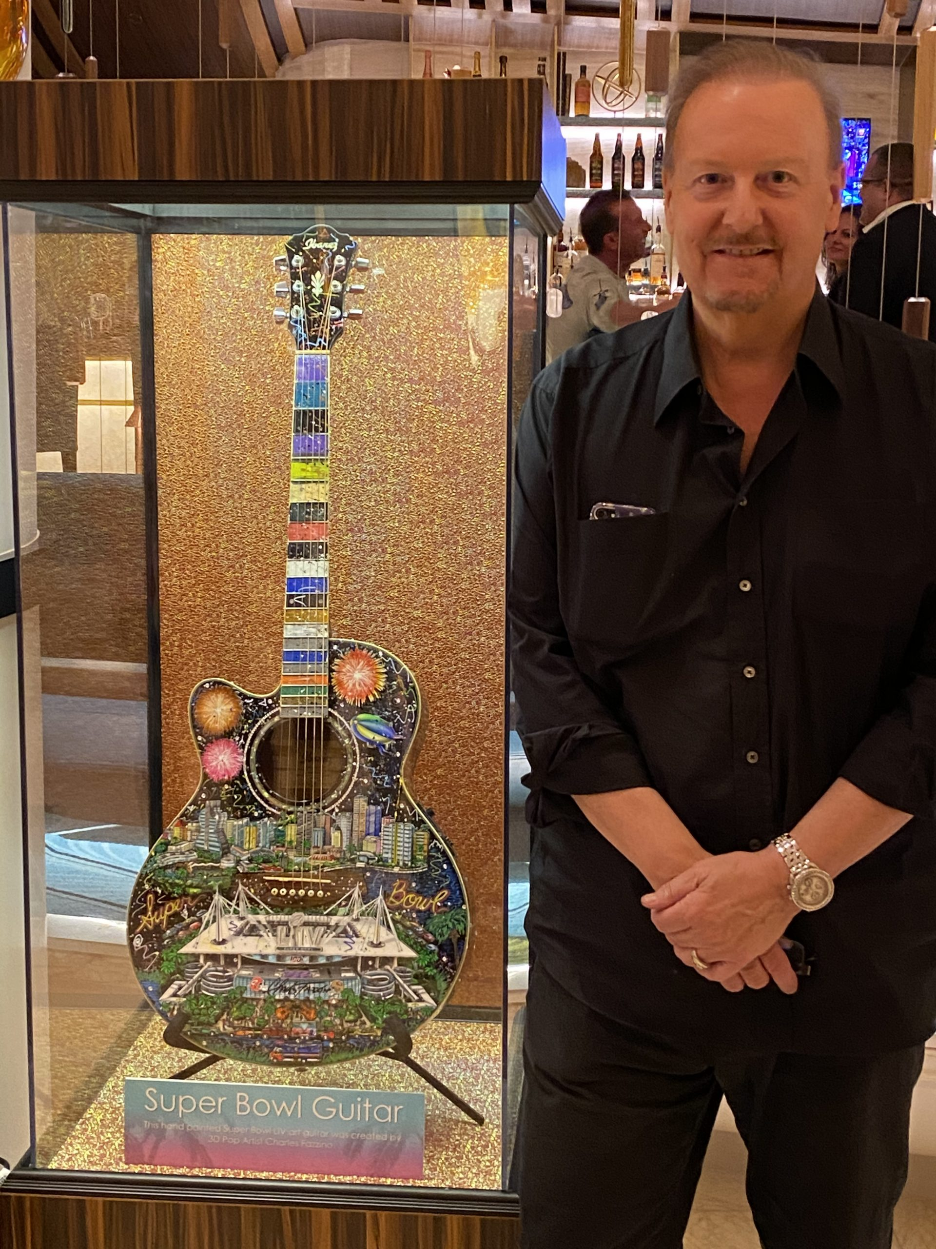 Fazzino standing next to his Super Bowl Guitar
