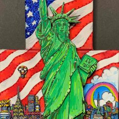 close up pop art piece of green statue of liberty and american flag in background - Charles Fazzino
