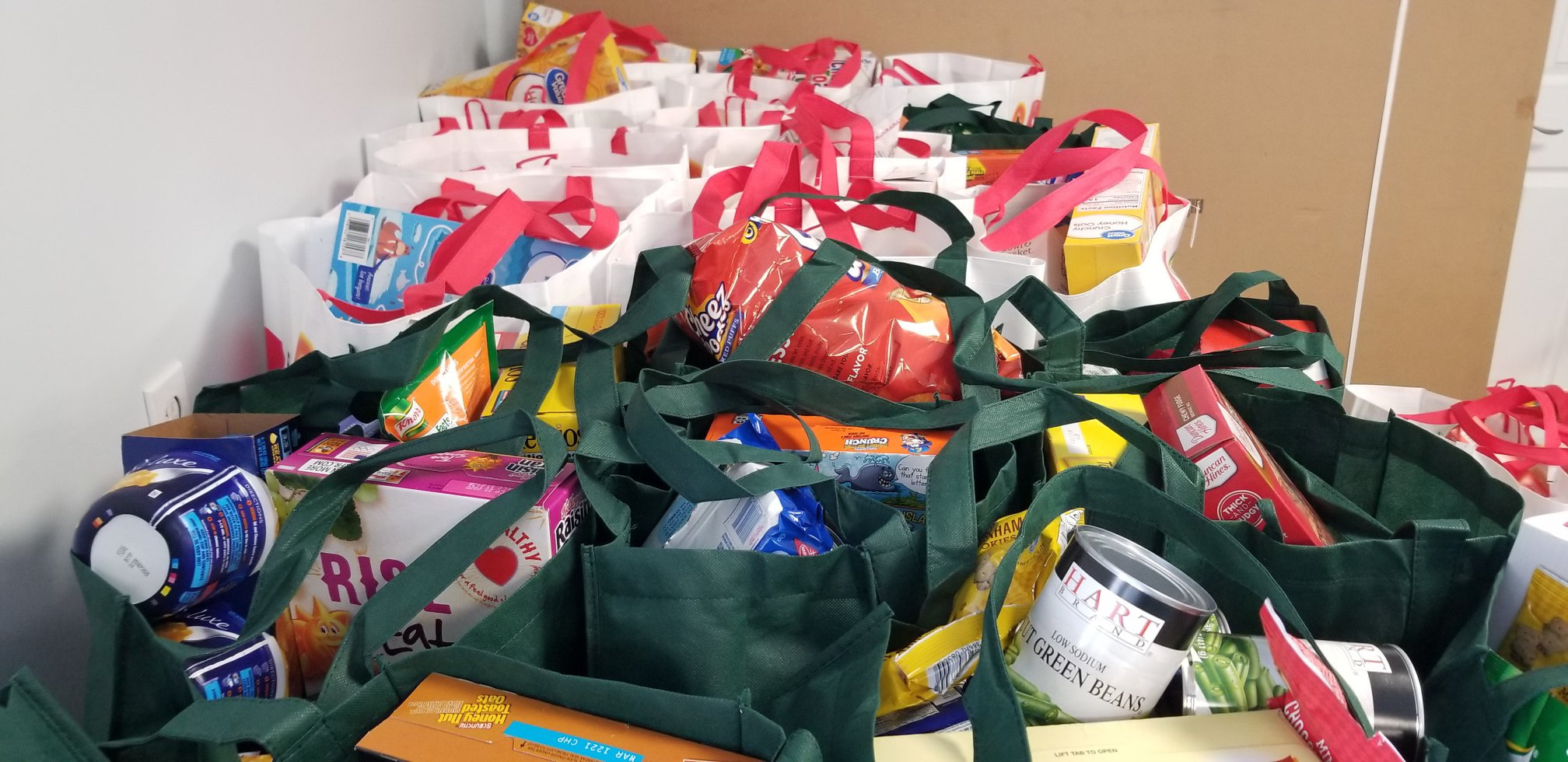 reusable bags full of groceries for thanksgiving food drive