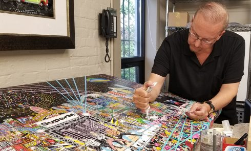 Charles Fazzino working on 3d pop art commissioned piece for SMTOWN Museum, Seoul, Korea featuring KPOP stars SUPERM