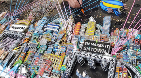 Close up of Charles Fazzino working on 3d pop art commissioned piece featuring KPOP stars SUPERM