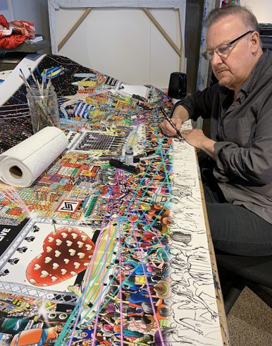 Charles Fazzino painting the 3D pop art commissioned piece for SMTOWN featuring KPOP stars SUPERM