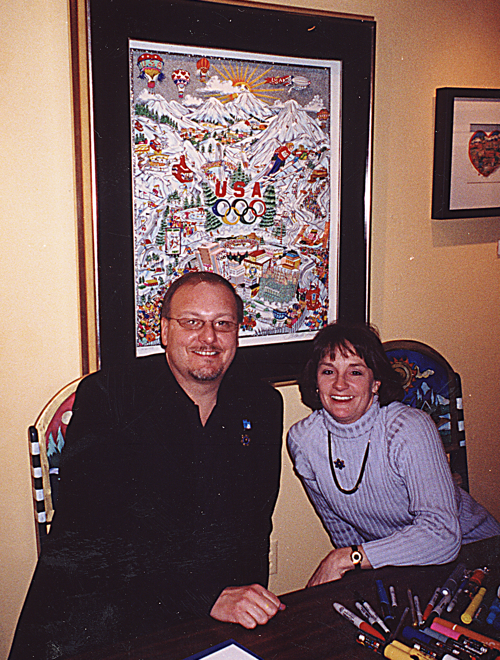 Charles Fazzino and Olympic Gold Medalist Bonnie Blair signing Olympic pop art posters at the 2002 Olympic Games in Salt Lake City