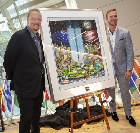"""Charles Fazzino and New York Mets, Pete Alonso standing next to Fazzino's pop art memorial piece titled """" 9/11: A Time for Remembrance, Twenty Years Later"""""""
