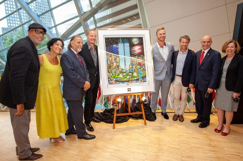 Charles Fazzino pictured with his pop artwork piece memorializing 9/11 Twin Towers titled 9/11: A Time for Remembrance, Twenty Years Later. Standing with Bernie Williams, Anthoula Katsimatides, Joseph Esposito, Charles Fazzino, Pete Alonso, Jeff Wilpon, Salvatore Cassano, Alice Greenwald