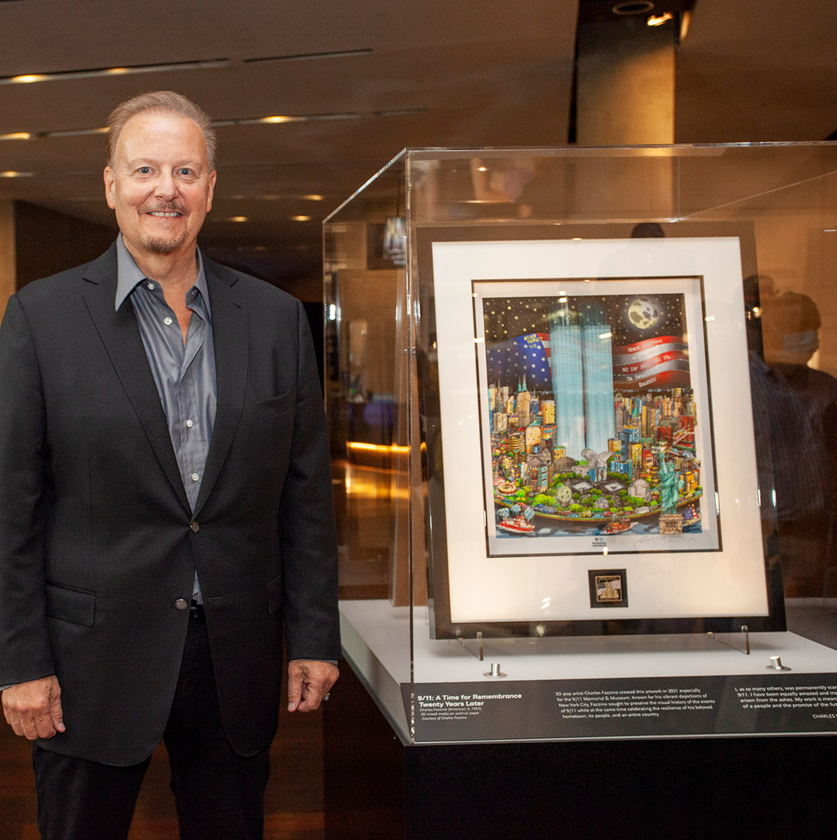 """Charles Fazzino standing next to his original memorial piece titled """" 9/11: A Time for Remembrance, Twenty Years Later"""""""